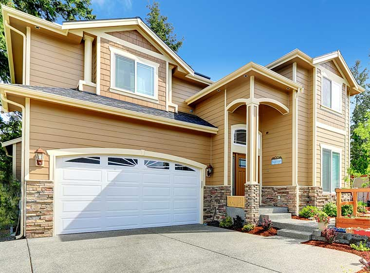 """""""two-story house with light brown painted vinyl siding"""""""