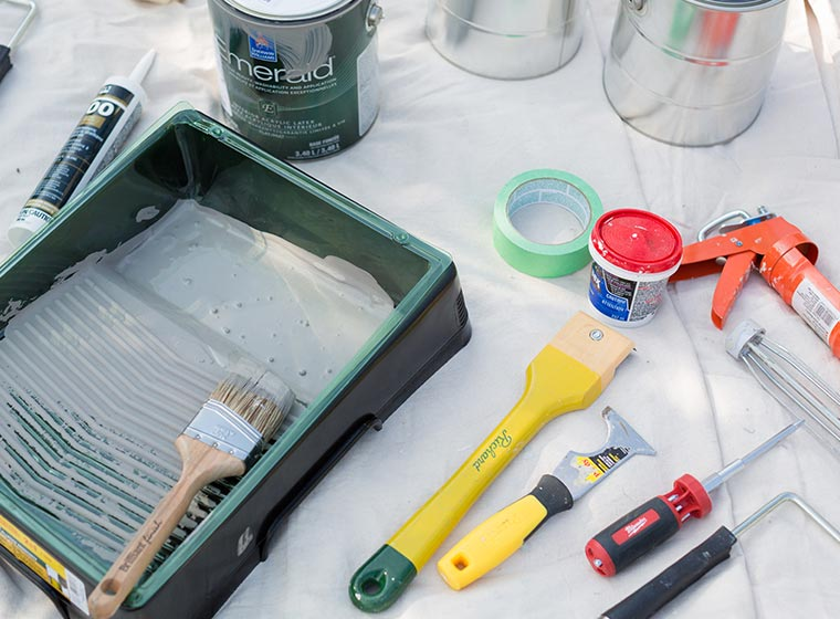"""""""Painting tools for exterior painting laid out on white cloth"""""""