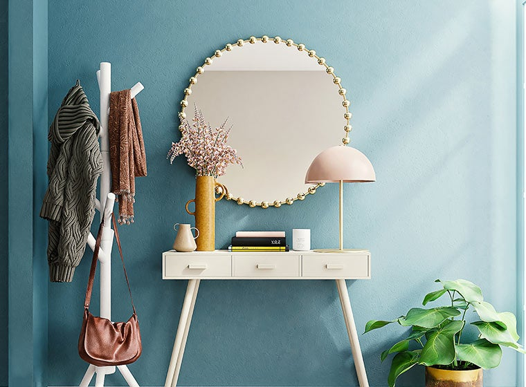 """""""Summer blue painted wall with mirror, entry table, and green plant"""""""