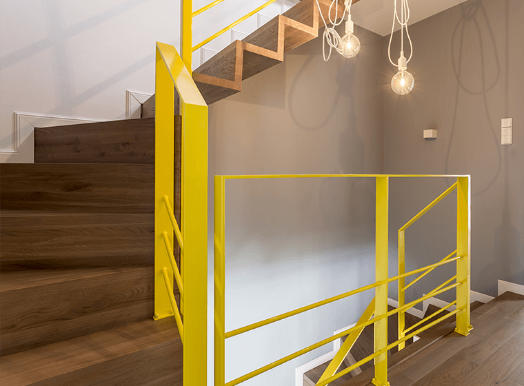 Staircase with Yellow Railings