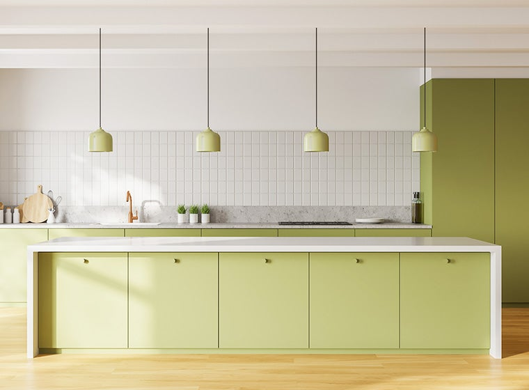 Open-concept kitchen with pastel green cabinets