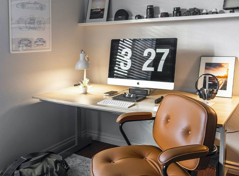"""""""Neutral grey toned home office with brown leather chair"""""""