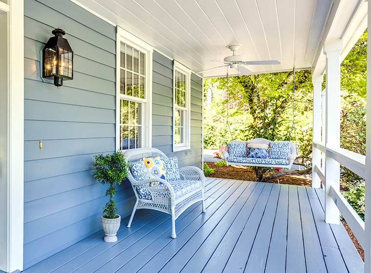 """""""Home with painted light blue deck"""""""