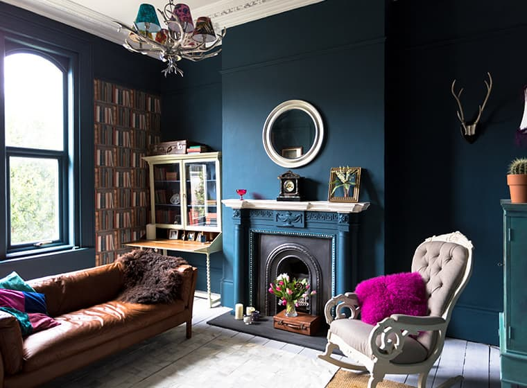 large living room with navy blue walls