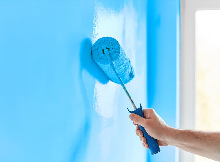 Painting wall skyblue with paint roller