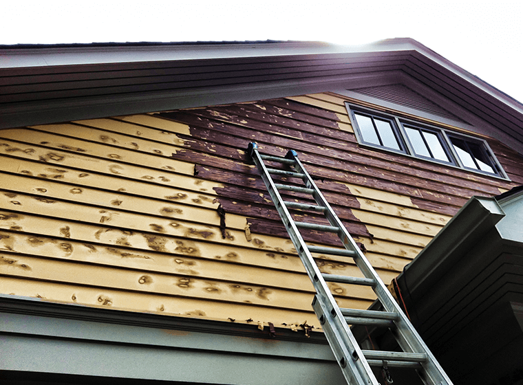 Damaged wood is a sign to repaint house exterior