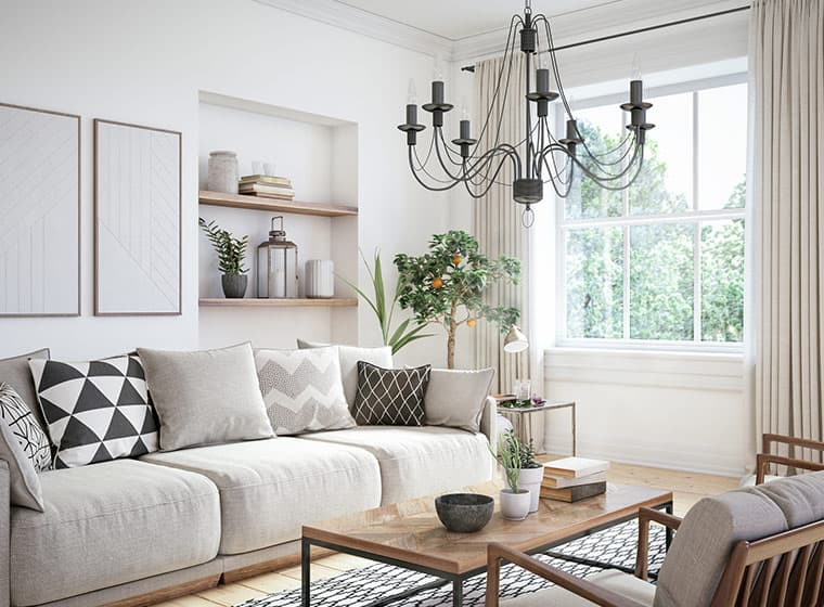 neutral color living room with fabric couch and white trim