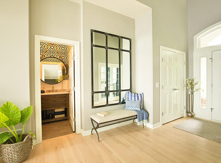 spacious front door entrance way with light brown flooring