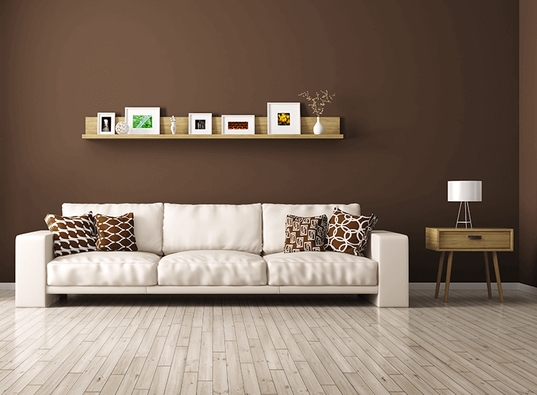 """""""White couch against brown painted wall"""""""