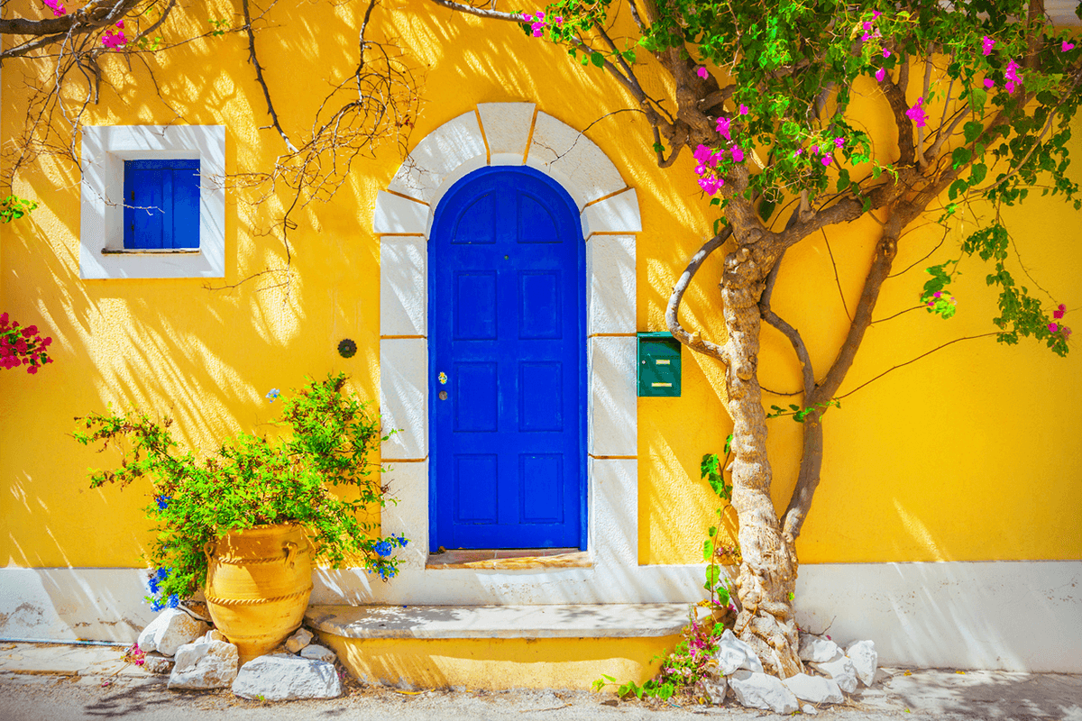Mustard Yellow House with Blue Door