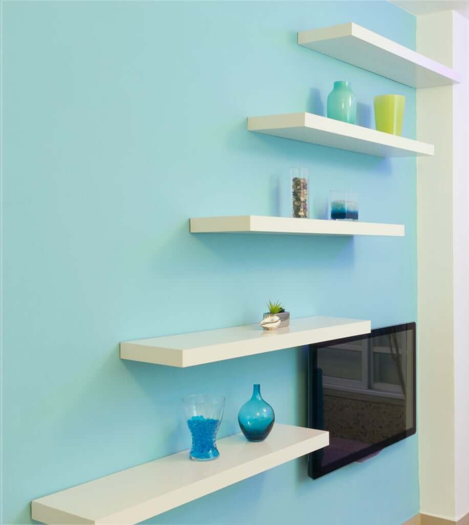 """""""Stacking shelves in unused space above TV unit"""""""