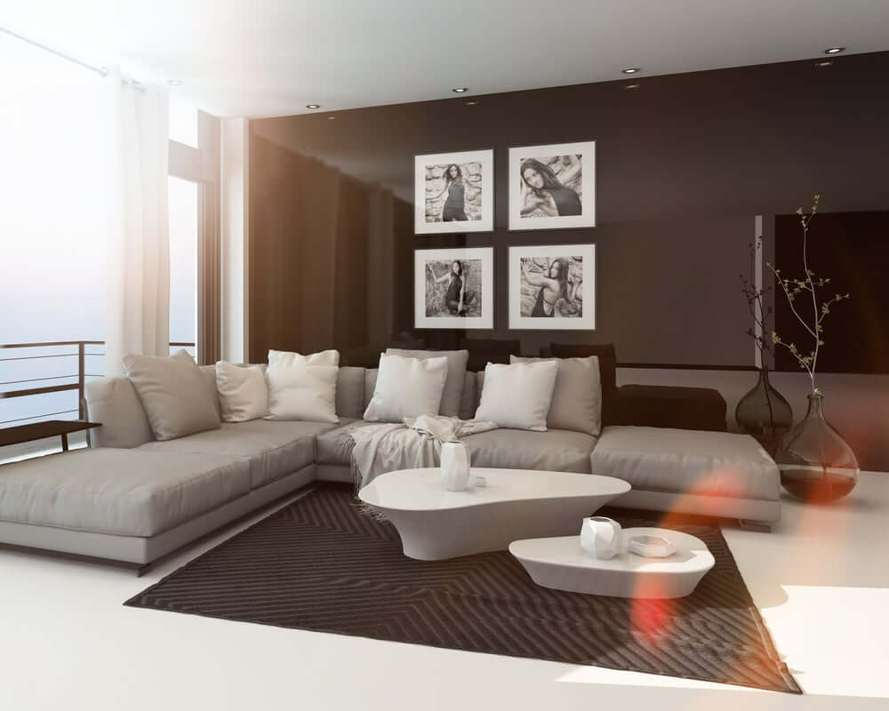 """""""Modern living room with black painted walls, """"L"""" sectional couch"""""""