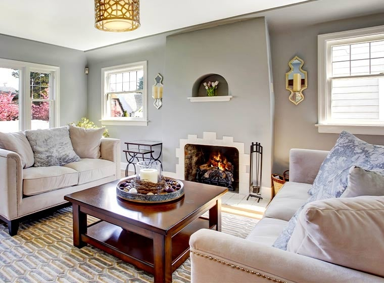 """""""Cozy living room painted light grey with homey furniture"""""""