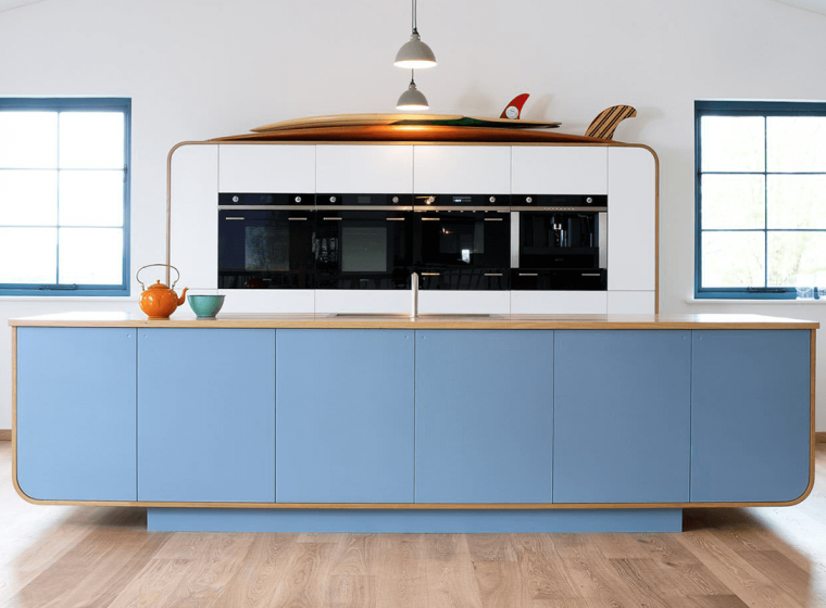 modern kitchen island with blue cabinets
