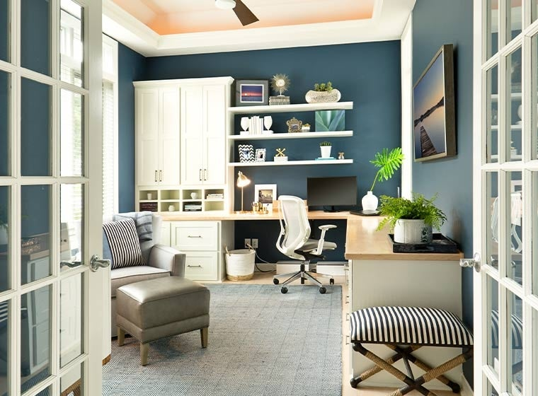 """""""Cozy warm light home office with navy blue walls"""""""