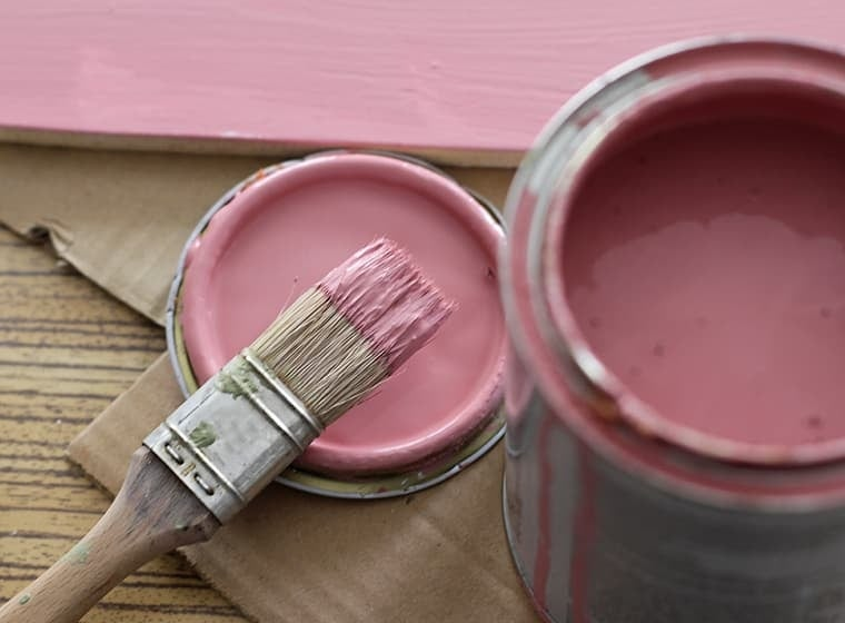 Paint brush with pink wall paint